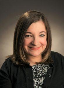 Photo of Dr, Kara Ayers. Smiling woman with medium length brown hair.